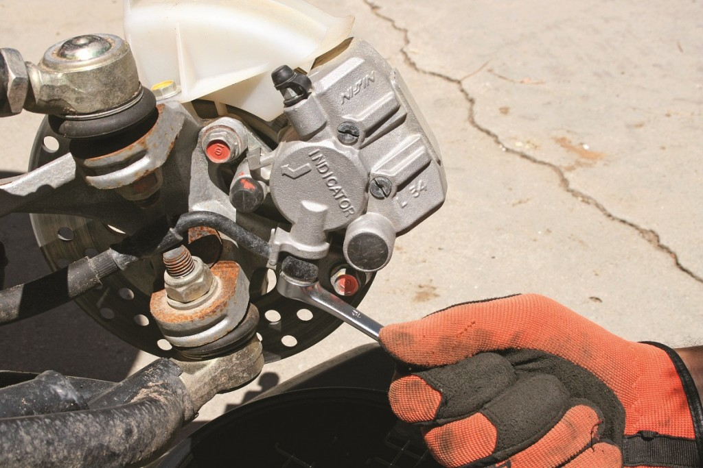 STEP 2: Follow the existing brake lines and determine all the mounting points; you will need to remove any bolts holding the lines in place. When all mounting bolts are removed and drain pans in place, you can now start with loosening the banjo bolts on the calipers.