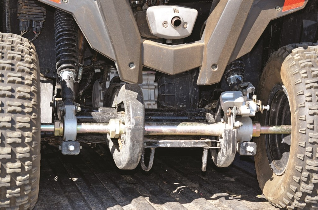 A 229cc, liquid-cooled, single-speed scooter engine is stuffed in front of the swingarm. That suspension moves 5 inches and has two preload-adjustable shocks.