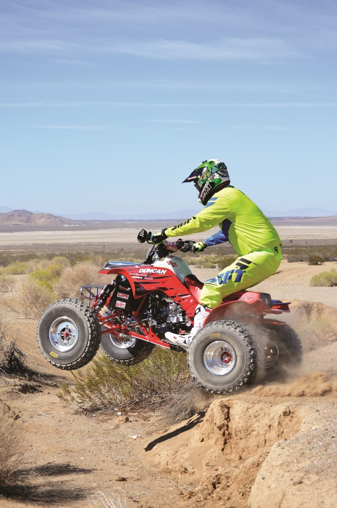 A 250R with modern conveniences like Fasst Co. Flexx handlebars help improve the already-protected machine. The power-valve motor from Duncan Racing takes it to the next level in the power department