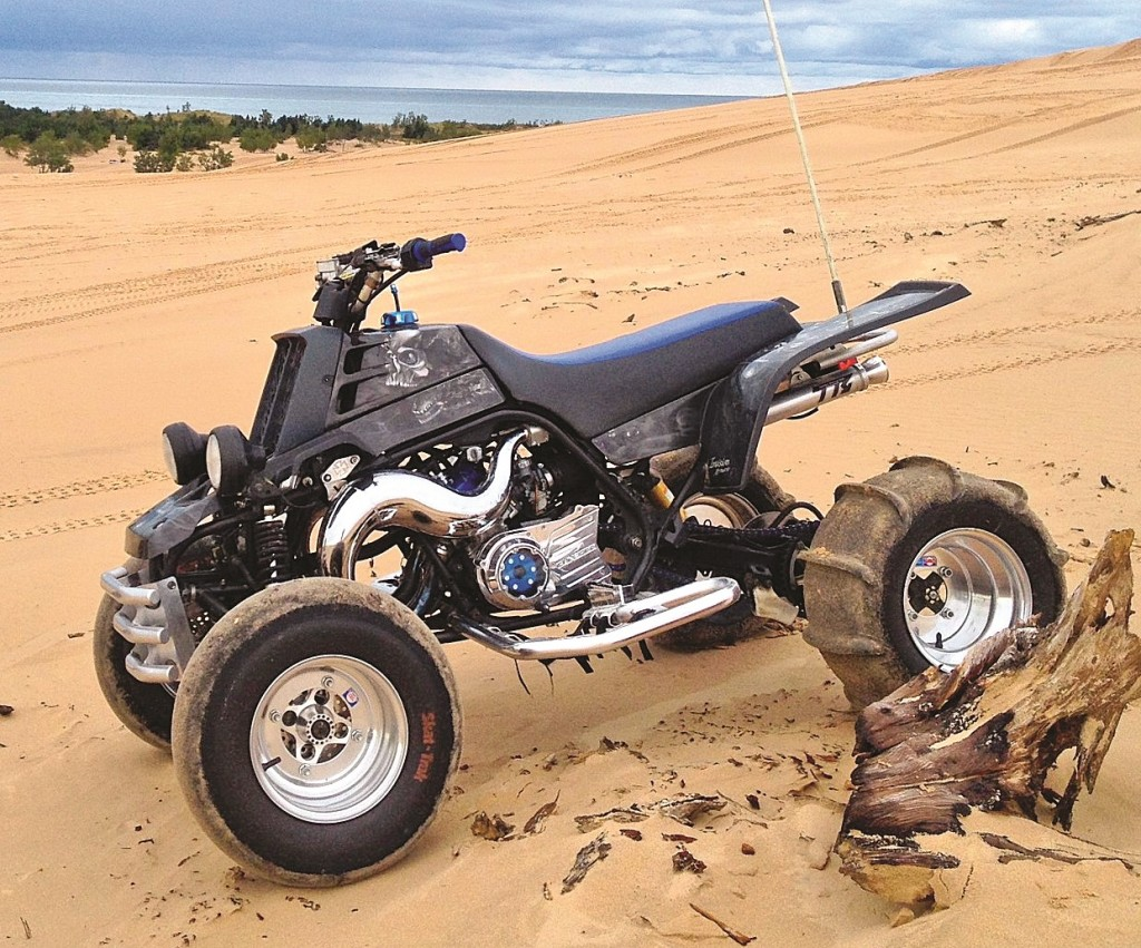 Trenton Crandall's 2006 Special Edition Banshee sits proudly at Michigan's Silver Lake Sand Dunes. It has ported and polished cylinders, milled heads, Toomey T6 pipes, V-Force reeds, lightened flywheel, advanced timing and over 30 Wiseco pistons.