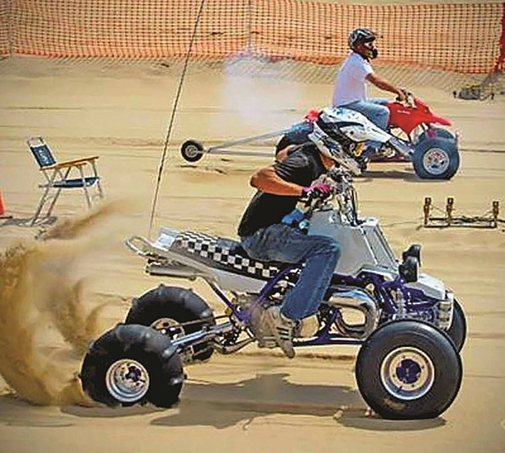 Here is Ronald Fetty and his 2001 Banshee running 5 seconds flat on the 1/8-mile sand drags at Dunefest in Oregon. His screaming machine has a 4-mil, 421cc Cheetah Cub engine pulling 100 horsepower at the rear wheels. The 6-inch extended swingarm and +1-inch A-arms help keep it pointed straight.