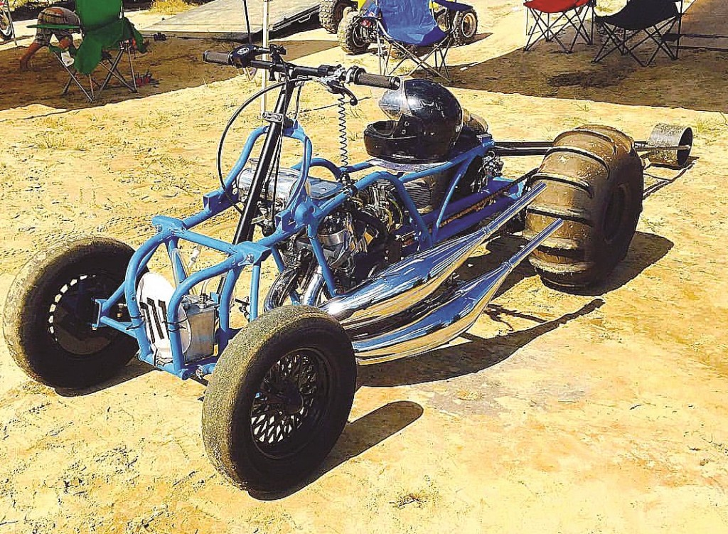 Kolbe Robinson's Banshee has been highly modified for sand and dirt drag racing in the Pennsylvania area. Along with many other go-fast parts, it runs a 4-mill crank. From a standing start it has covered 300 feet in 4.1 seconds.