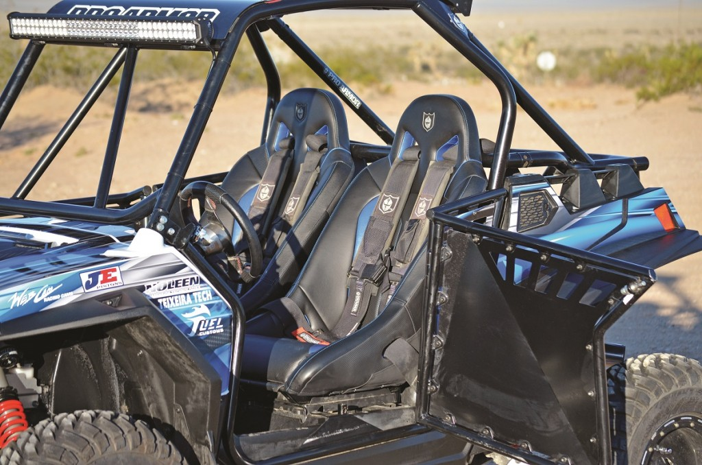 Door, seats, harnesses and a cage in that order are very popular bolt-ons for any UTV. In this car Pro Armor products are used throughout. They have been in the game for longer than most and their products show.