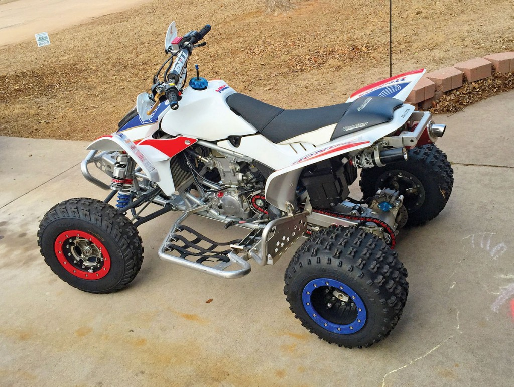 Here is Joe Czarnecki's Honda 450R in Oklahoma. It has a Lonestar stem and frame gusset kit for added strength, JB Racing long-travel A-arms, PEP shocks, Roll Designs Pro Peg nerf bars, Pro Armor skid plate, Hiper Tech wheels, Moose Racing front bumper, Tag handlebars, Quad Tech seat, Sparks Racing pipe/jets/intake, and much more.