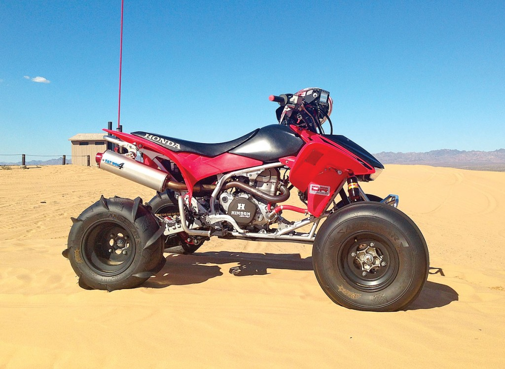 Kevin Neal is the original owner of this 2006 450R, and he keeps it running strong with engine rebuilds by Duncan Racing. He also has their Fat Boy pipe and front bumper, along with Elka shocks, Roll Design A-arms, footpegs, heel guards and steering stem. Other items include a Hinson clutch, Lonestar axle and locknut, Fasst Co. Flexx bars, and Rigid Industries 10-inch LED lights. Kevin likes to head over to the Glamis dunes from his home in San Diego.