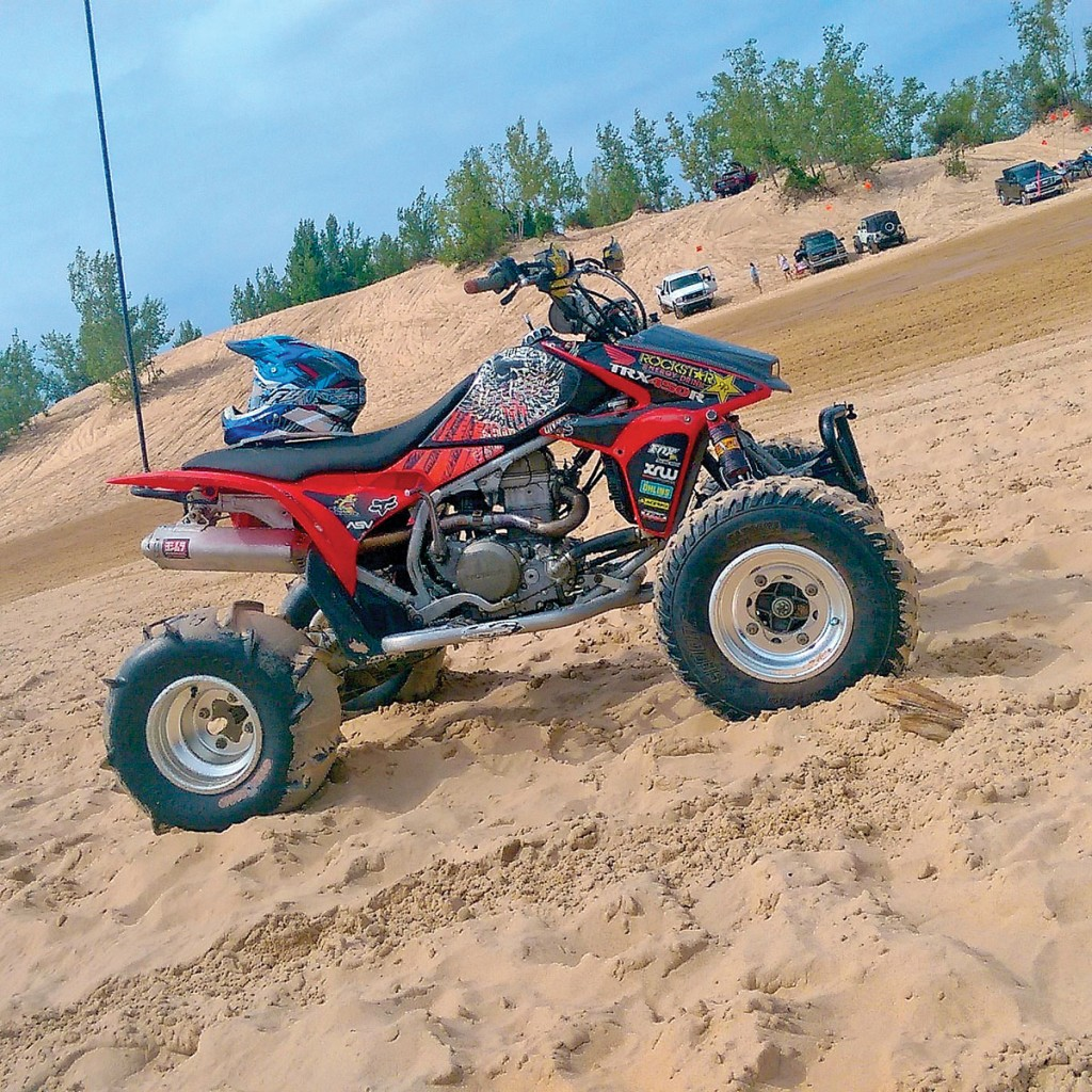 Darren Gutierrez has his 450R set up for riding at Michigan's Silver Lake Dunes. It has a 13:1 piston, ported and polished head by Rage ATV, Stage 2 hot cams, full Yoshimura exhaust, Stage 4 Elka shocks, aftermarket axle and much more.