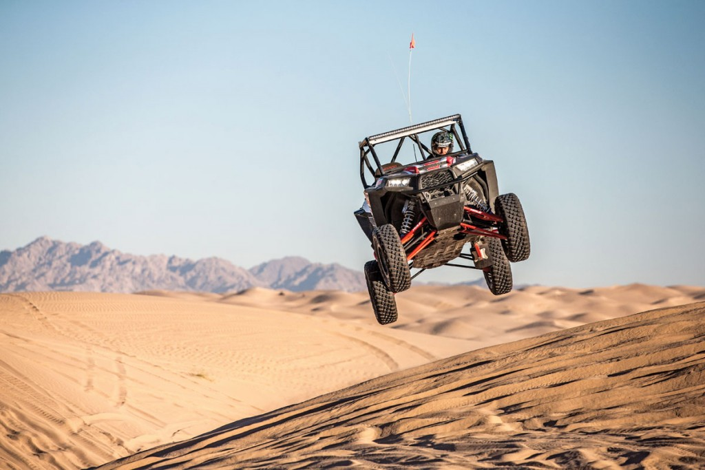 Polaris RZRs can take a lot of abuse, including jumping big jumps. Glamis has no lack of big jumps and fun terrain to drive on in the sand.