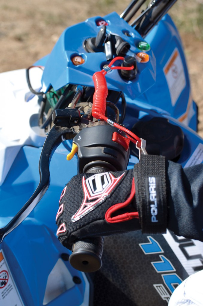 Several safety features are supplied on the Polaris minis, including a throttle limiter and this ignition tether. Both quads also come with a free safety flag and helmet.