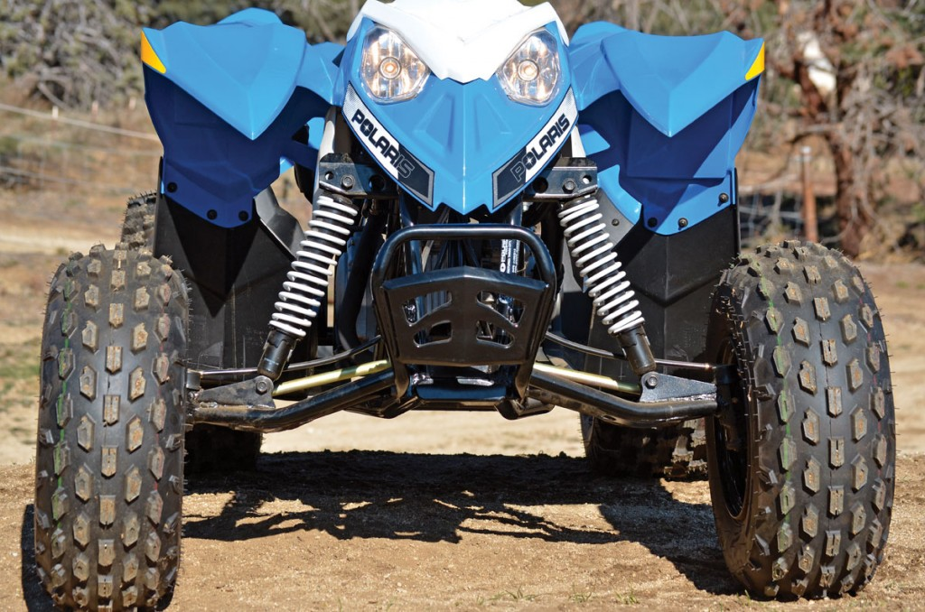 Single A-arms provide 5 inches of wheel travel. The shocks are not compression adjustable but work fine for general use.