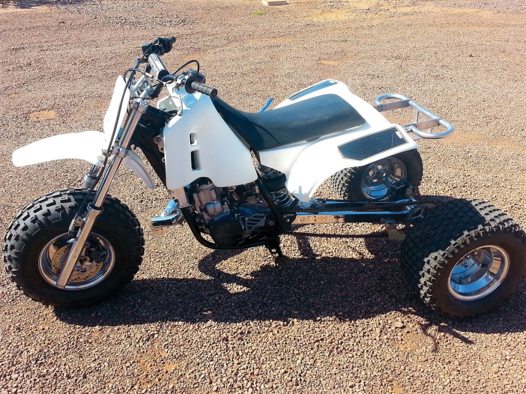 Here is Steve Klopping's ATC500R that he recently built. It has a Honda CR500 frame, radiators and aftermarket gas tank. The rear subframe is from a ATC250R so that the seat and rear fenders would fit properly. The +12 swingarm was added for drag racing up sand dunes, and the CT drag pipe helps for that as well. The cylinder was re-sleeved to accept a 89mm Pro-X piston. The front end is from an ATC250R. Steve's buddy, Bryan Witt, helped with this project, and they're both proud to ride it in the Arizona area.