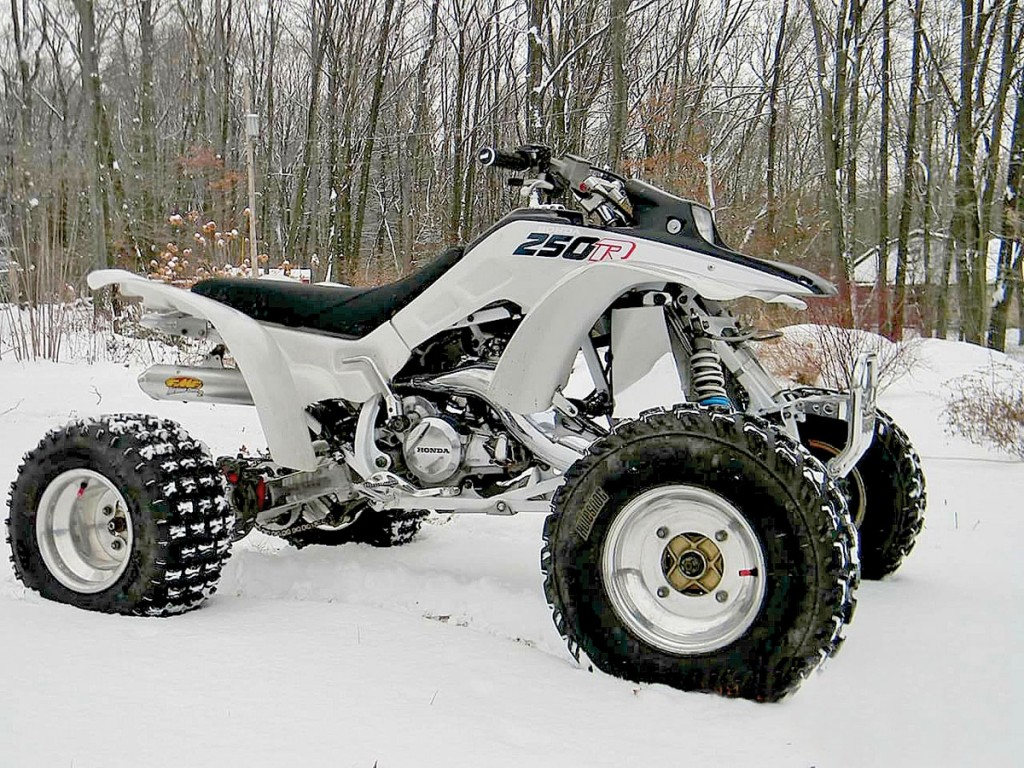 Back when Calvin Myers was a kid in Pennsylvania he dreamed of owning a Honda TRX250R. It took him 20 years, but he now has that dream machine. Here is his 1988 model after he gave it a thorough rebuild. It has a 310 sleeper motor, 38mm carb, FMF pipe, Works shocks, Lonestar steering stem and axle, ESR shifter and levers, polished TRX450 front bumper and much more. His legendary machine looks mighty clean in the snow.