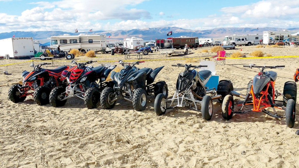 Chris Aguilar lives in Nevada, and he likes to ride at Sand Mountain with his family. Here are their machines lined up, with Chris' Raptor 778 the second one from the right. It has been set up for sand drags by Outlaw Innovations in Arizona with a 58mm throttle body, Mad ignition, Monster pipe, direct-drive lock-out clutch, +8 swingarm and much more. Looks like it'd have a good shot of being king of the mountain.