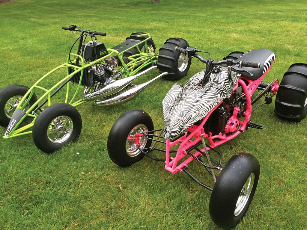 Nick Emery and his wife have gotten into dirt drags in the Michigan area. He rides the green Banshee with 611cc billet cylinders ported by K&T, billet heads and cases, Lectron carbs, 2-5 cut transmission, Shearer pipes and a stretched-out custom frame. His wife's pink YFZ has a modified frame with a +8 swingarm. The engine has a +4 Falicon crank and Athena cylinder making it 498cc. It has a 15:1 piston and +2 valves with a 1-4 cut transmission. The plastic was hydrodipped with the zebra pattern.