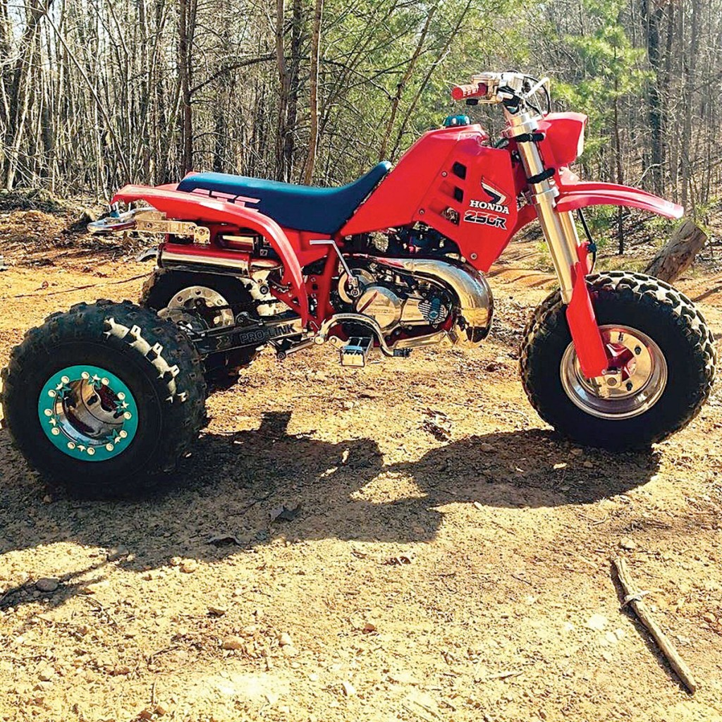 Tim Graham gets down the Virginia trails very quickly on his Honda ATC250R here. It has a 350cc cylinder, shortened CR125 forks, +4 swingarm and custom beadlock rear wheels. It looks like he has also done some polishing and chroming on some other parts as well. His ATC looks very clean and business-like.