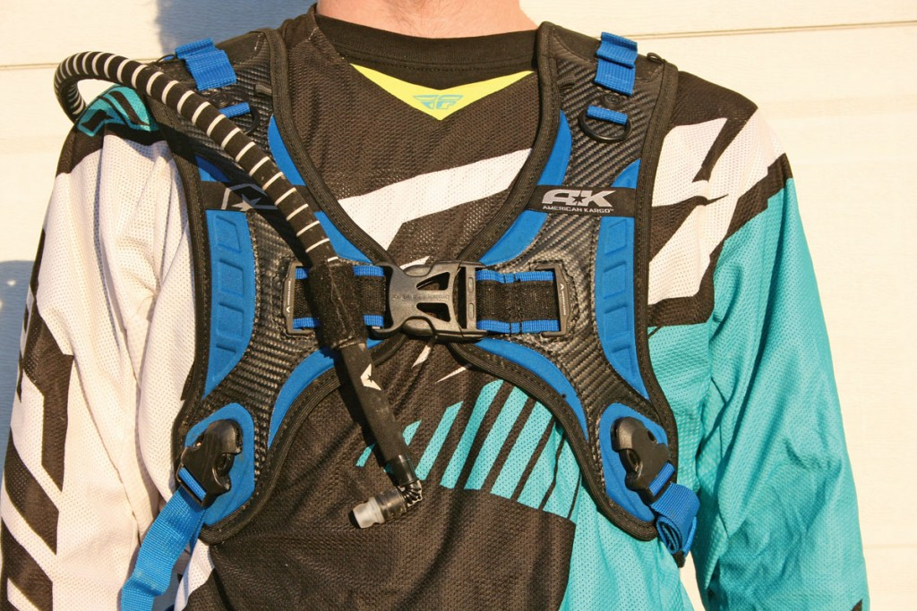 The front harness system clips together with one large buckle in the front. The water tube is insulated and can Velcro to the front of the harness for easy access.