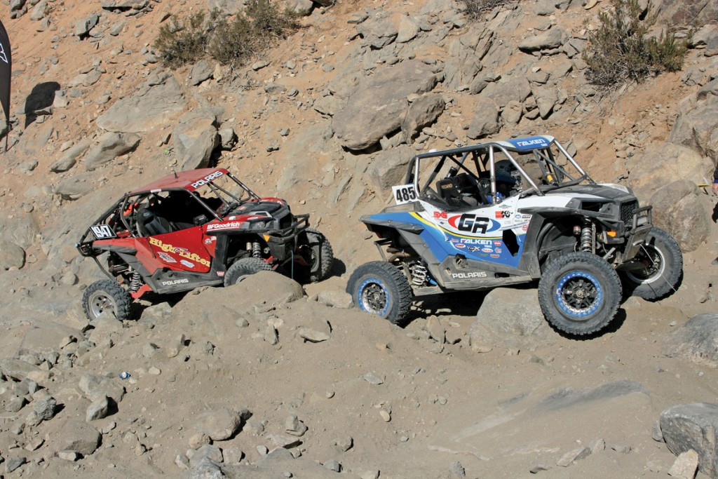 Oftentimes racers get blocked in by other stuck competitors and have to find a way around them. This High Lifter-sponsored Polaris RZR had to wait behind #485 through this part of the course called Chocolate Thunder.
