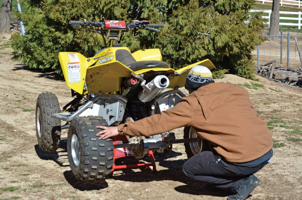 1) With the quad on a stand, grab the rear tires and rock them from side to side. This will expose any worn-out bearings in the rear surrounding the axle or up front at the pivot points.