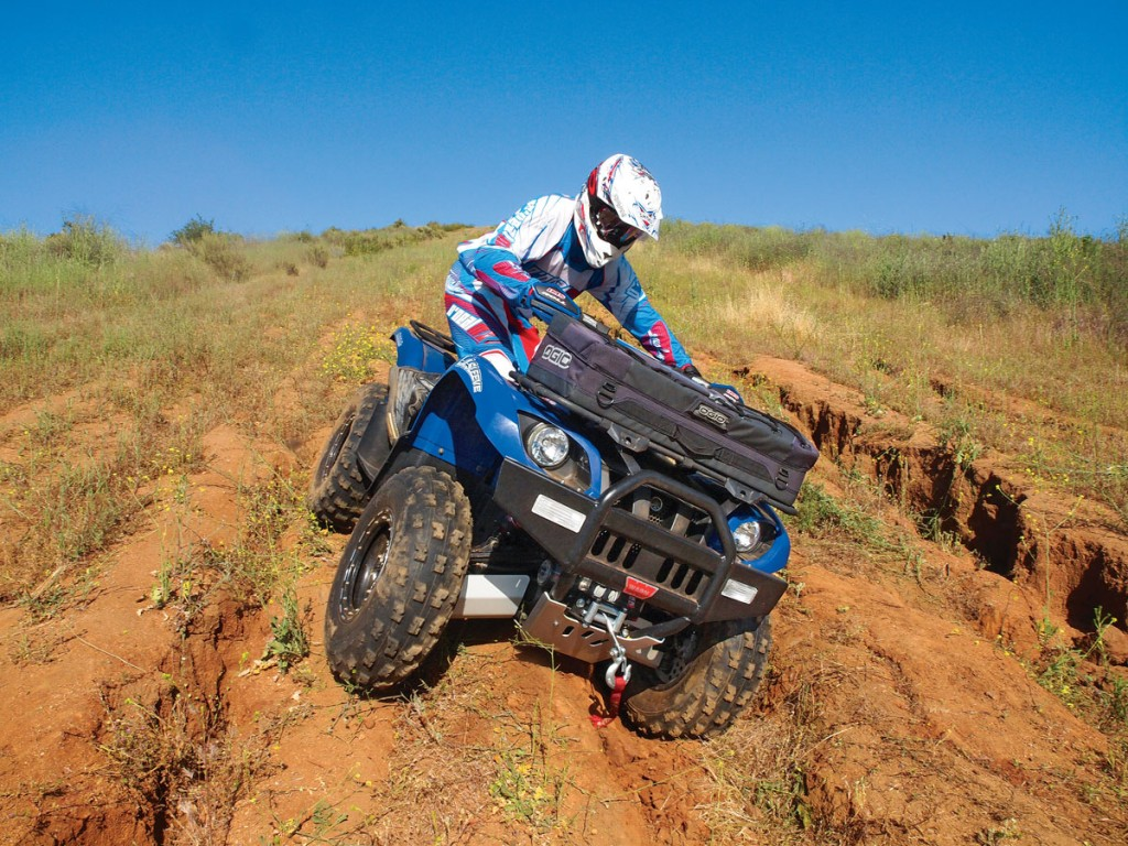 When an off-camber trail is too extreme, don't take a chance. Put both legs on the uphill side and hang off like a human counter-balancer. This way, if the quad starts to tip, you can safely step off before getting trapped.