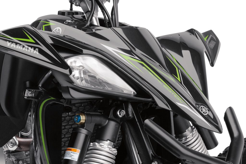 The Yamaha sports two headlights with high and low beams for night riding and racing.