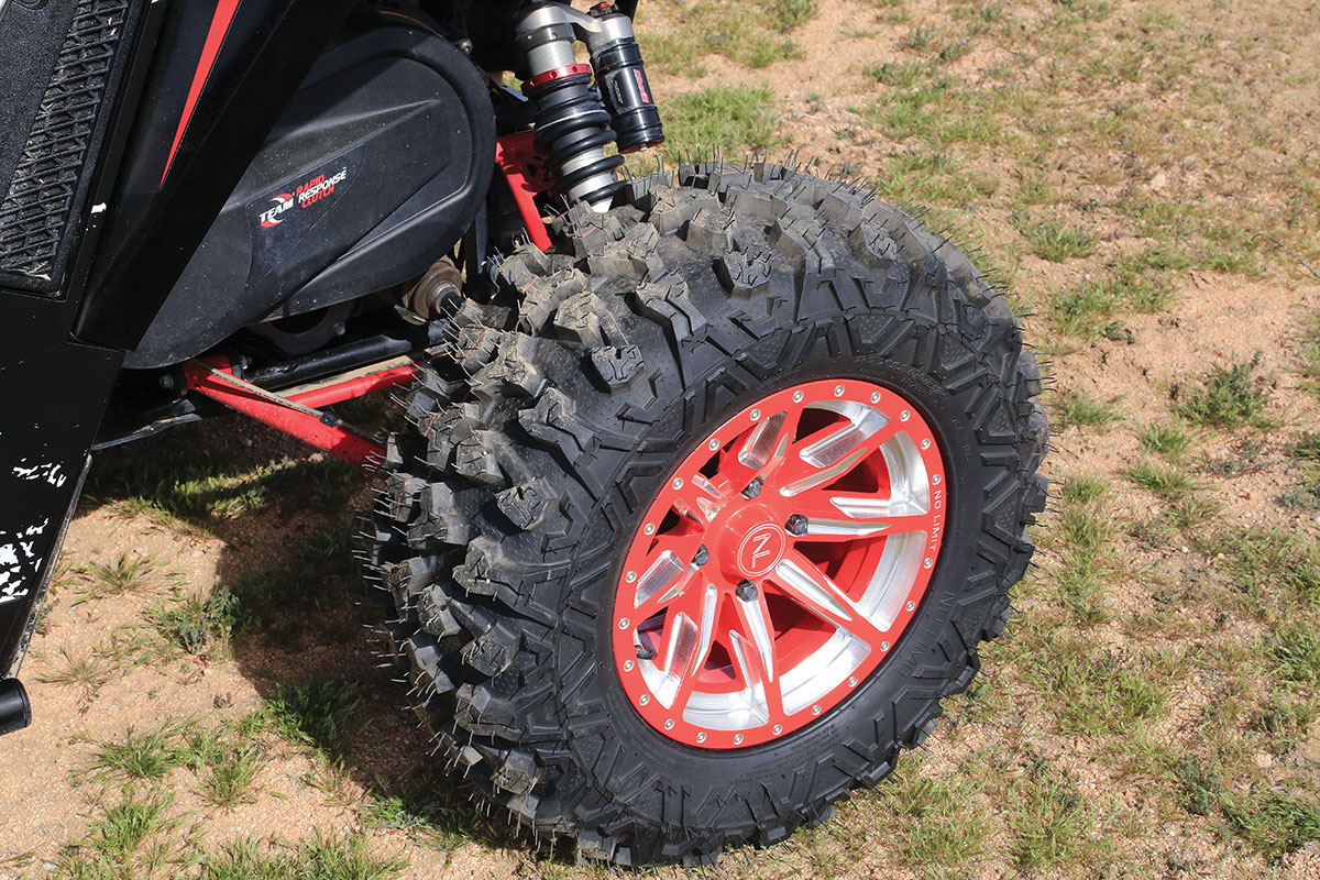 The wheels we chose are custom-cut No Limit Octane in Arctic Cat Red. We wrapped the rims with No Limit's Patriot 27-inch tire. The rim edge holds the tire very well at low pressure without the need of a beadlock.