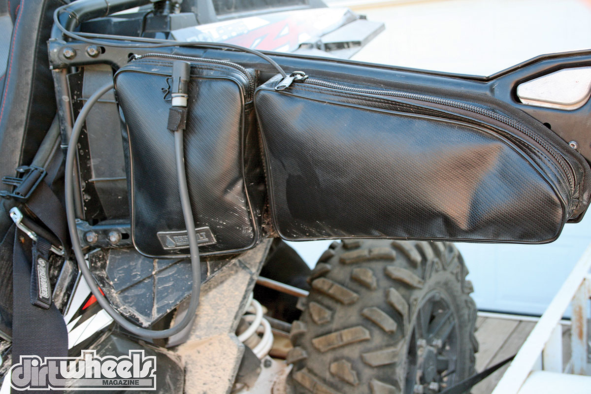 Installing the Assault Industries Hydration door bags takes little time on a stock Polaris RZR door & GEAR GRINDER: ASSAULT INDUSTRIES HYDRATION DOOR BAGS | Dirt Wheels ...
