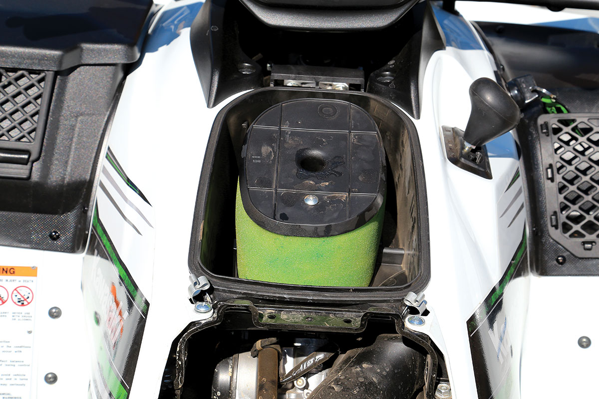 The air filter system on the Kawasaki is easy to get to. Take the seat off, then release the clips holding the door on that is right behind the handlebars, so maintaining the filter is easy.