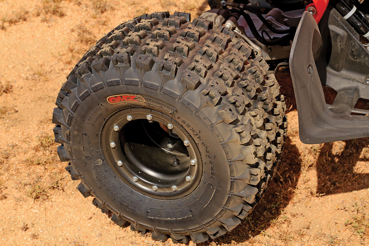 The rear 22-inch tires have tall lugs that grip hard in many different types of terrain. They will break loose and help you slide around turns when needed.