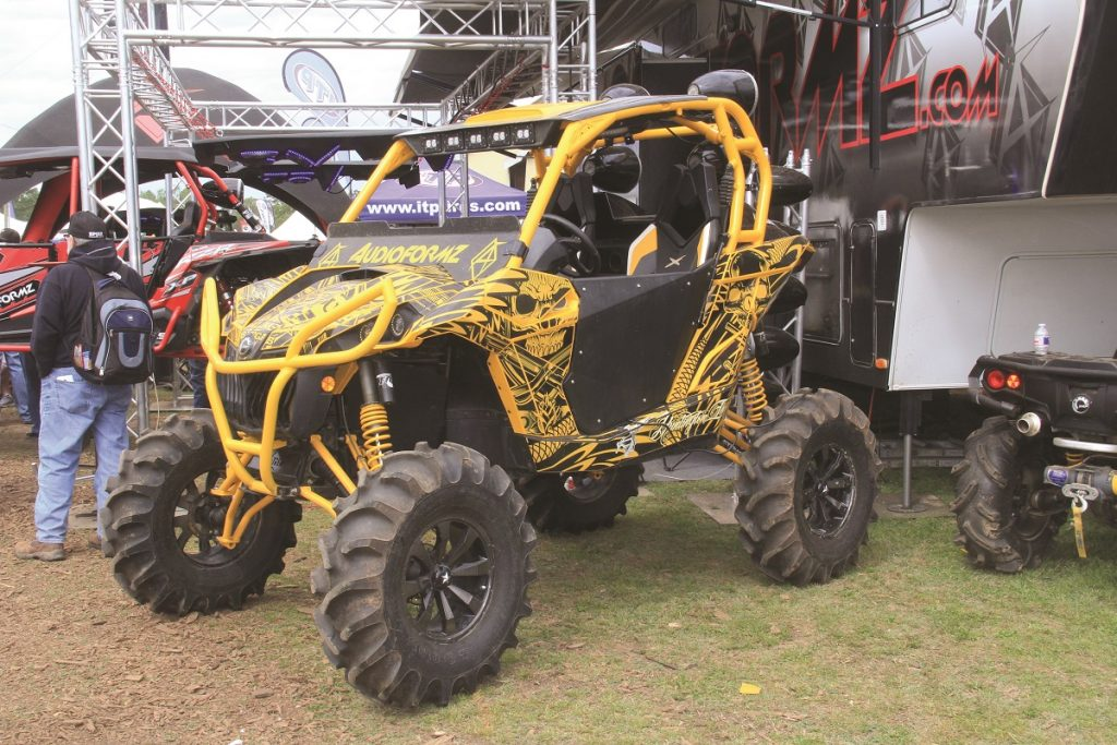 A lot of machines at the Mud Nationals were lifted with big tires that are meant to dig through sludge. Aftermarket doors, roll cages, and wheels, tires and sound systems are common on these machines.