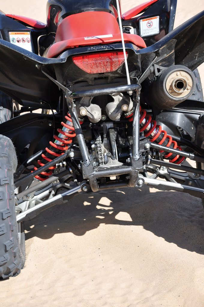 A centered chain drive is standard equipment on the back end of the independent rear suspended Honda 700. Wheel travel is 9.3 inches in the back and 10.5 inches in the front.
