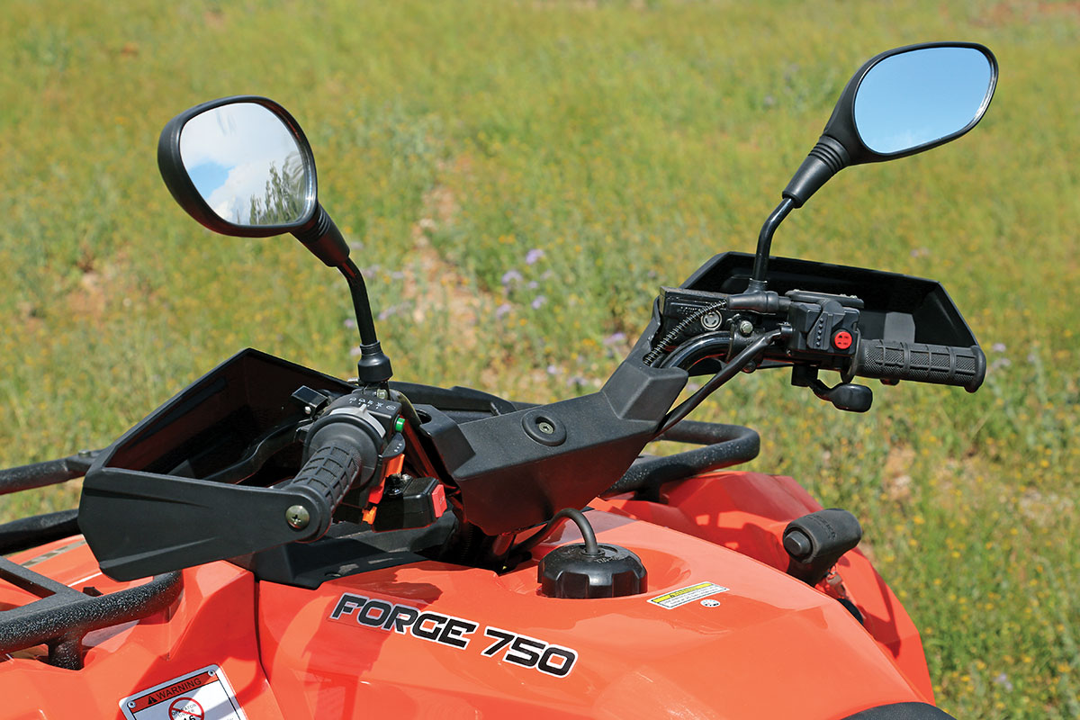 "These two-up ATVs are commonly called ""touring"" models, and the seated accommodations and swept-back handlebar do feel like a touring bike. The impression is aided by standard mirrors and turn signals."