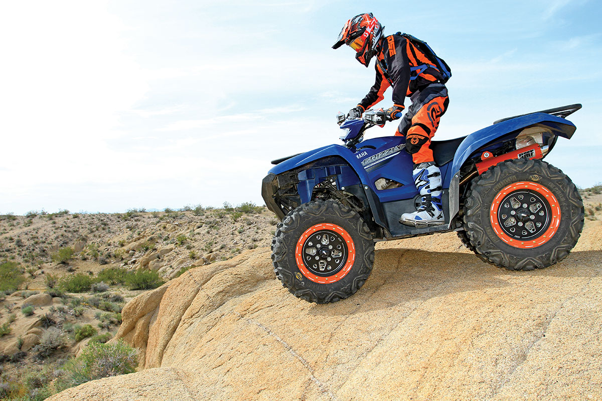 When it comes to grip, DWT's Moapa tires work well in rocks and just about any other terrain you ride them through. The beadlock rims are their Stealth-Lok wheels with orange rings.