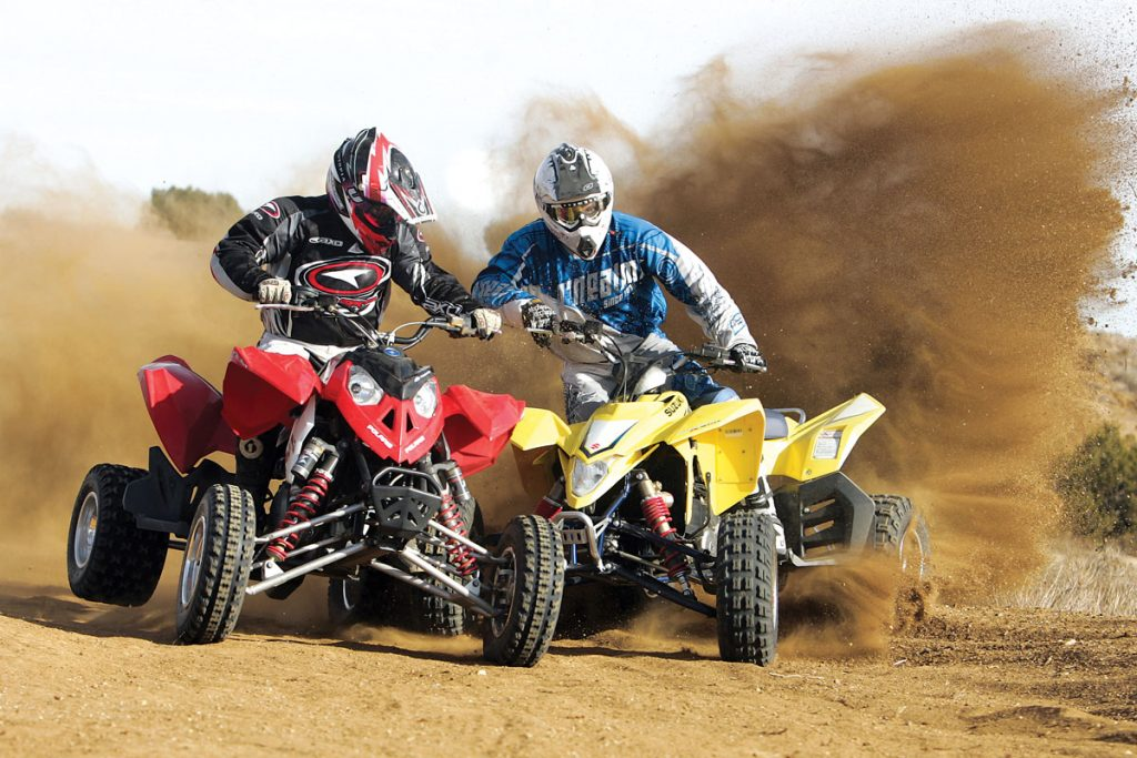 Suzuki and Polaris outfitted their 450s with low profile 18-inch rear tires. This setup works great on a groomed track but not on the trails. We wish Polaris had supplied a wide axle and wider A-arms to go along with their MX moniker.