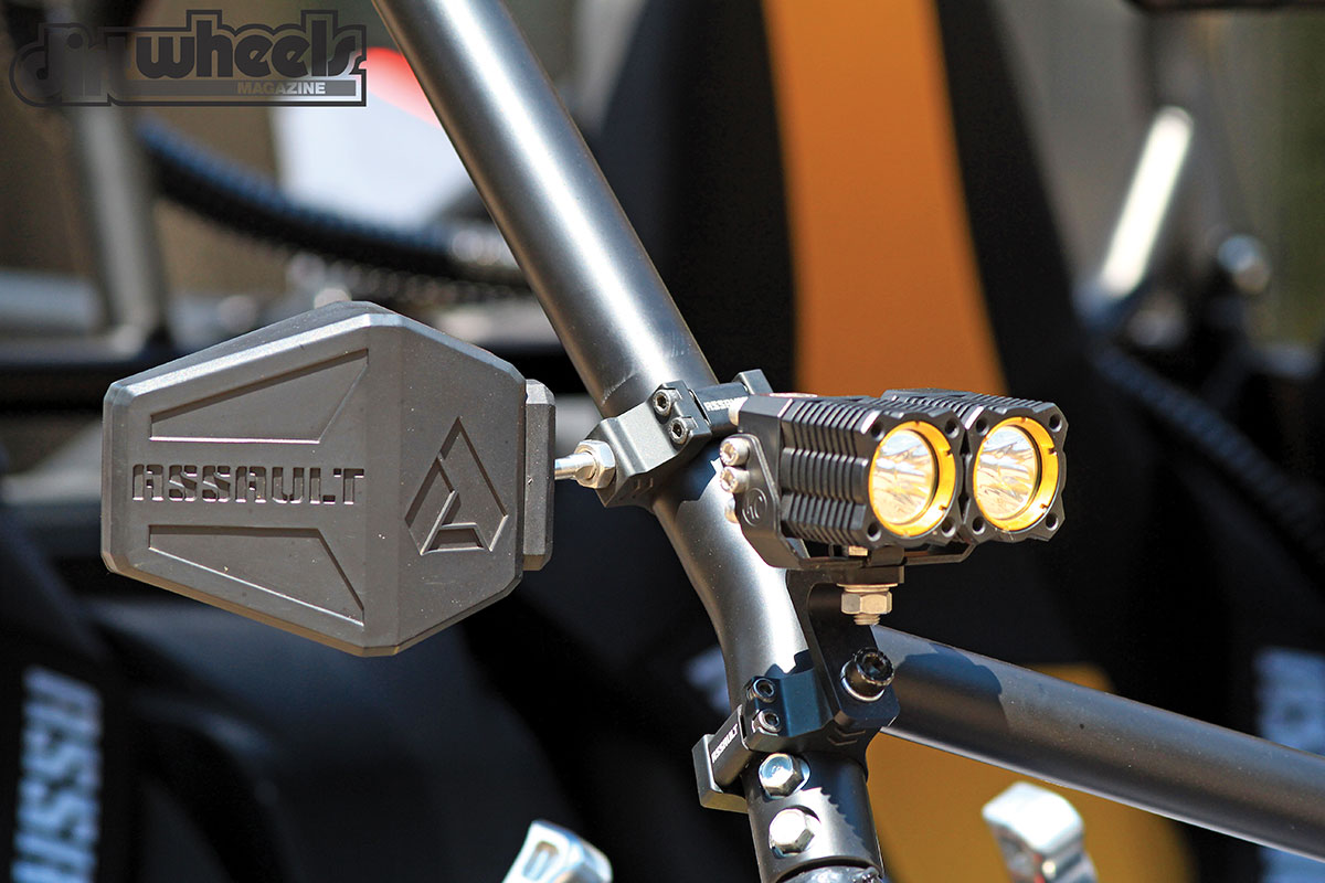Assault Bomber-series rear-view mirrors help you see riders or racers in your dust, while the KC Hilites Flex lights mounted on the A-pillars of the roll cage help light up the night.