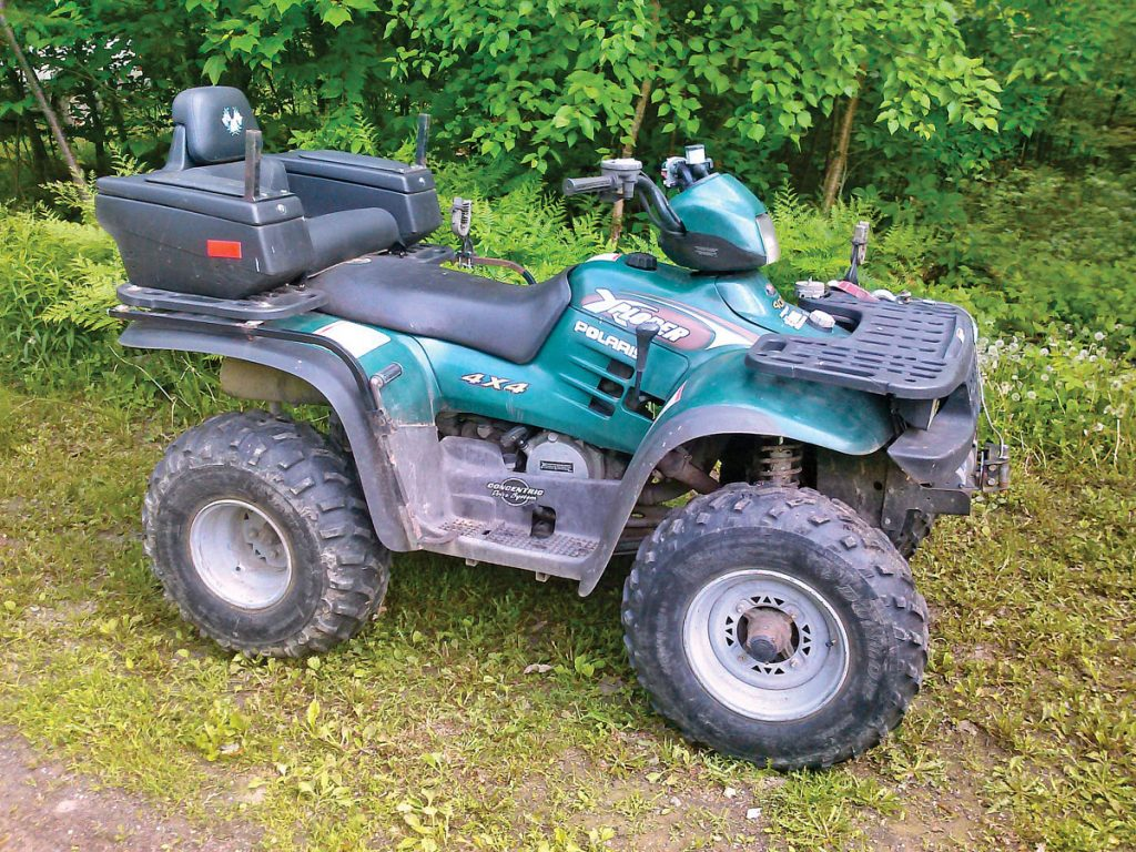 Chuck Fish's 1999 Polaris Xplorer 400 is pretty much stock, except for a storage box seat in back. He says his old twostroke 4x4 still runs with the best.