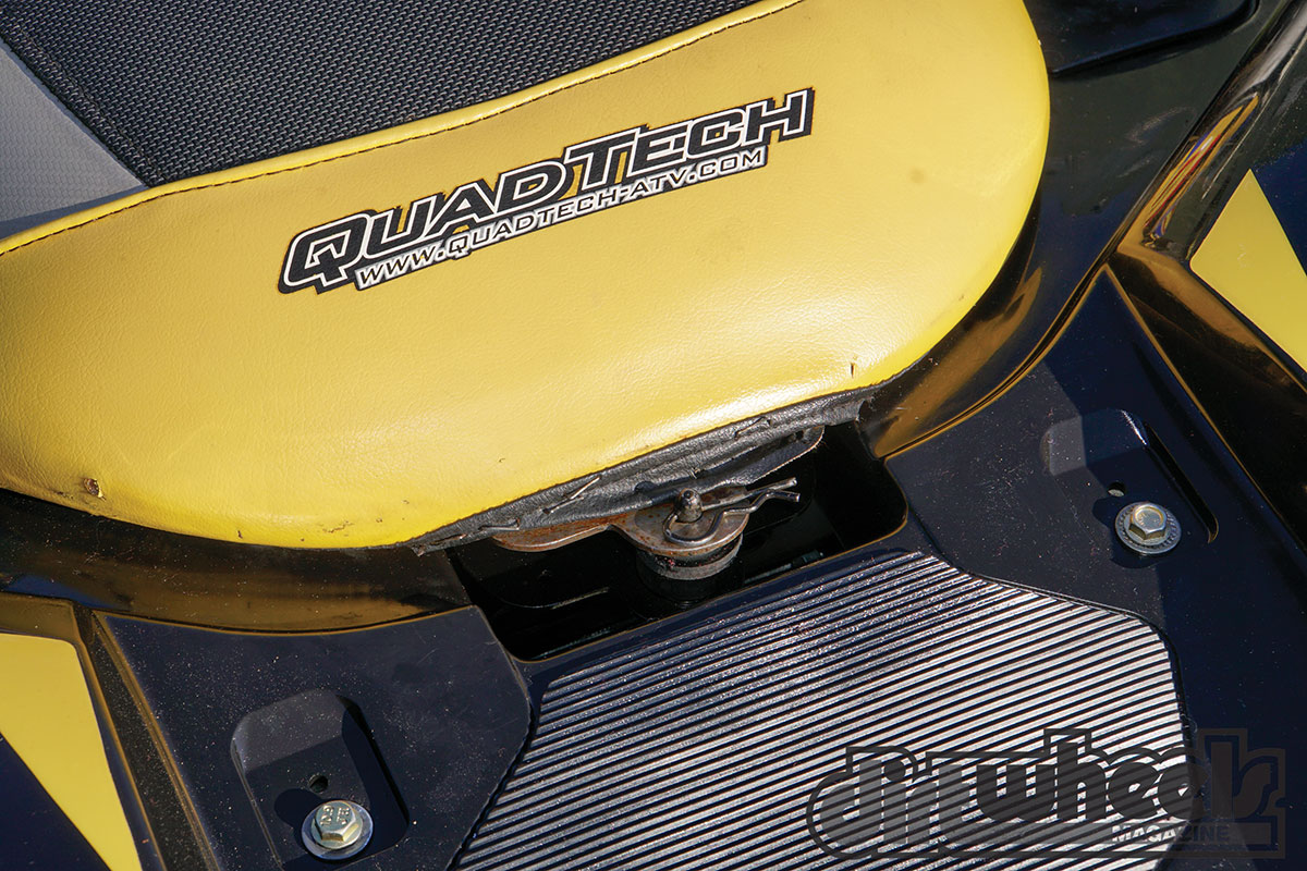 The Quad Tech seat's gripper material kept us from sliding around while riding, even in the mud. Buckhannon had a custom seat latch made so his seat won't fall off during a race.