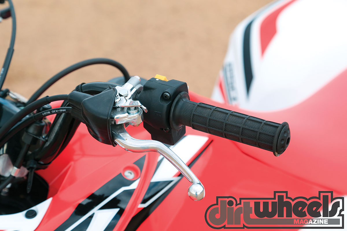 It is clever how Honda uses the clutch lever to engage the parking brake. We do wish the machine would start in gear.