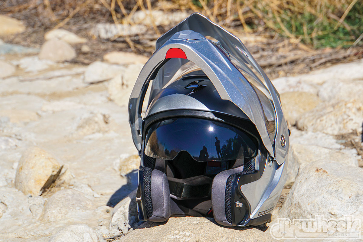 The chin bar of the EXO opens up so you can talk to people easily or catch a breath. There is a drop-down sun shield built into the helmet that is operated with a slide switch.