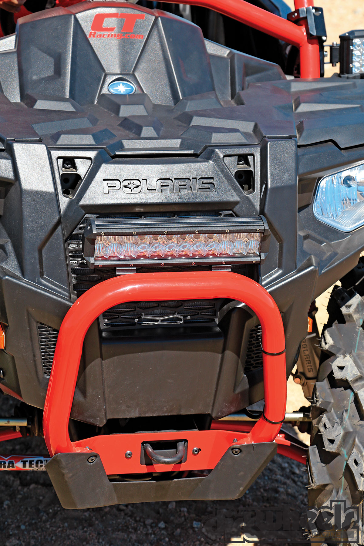 We like the compact light bar, and it is nice that the Polaris bumper retains the tow loop.