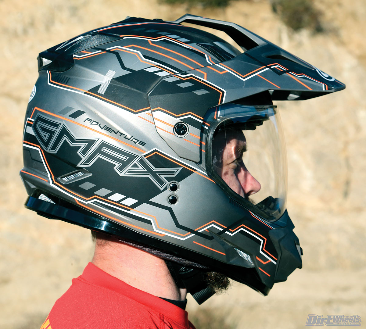 GMAX's GM11 ADV helmet is full-featured and comfortable with a shield that wears well without scratching. All of the features come with a penalty. It is a little heavy.