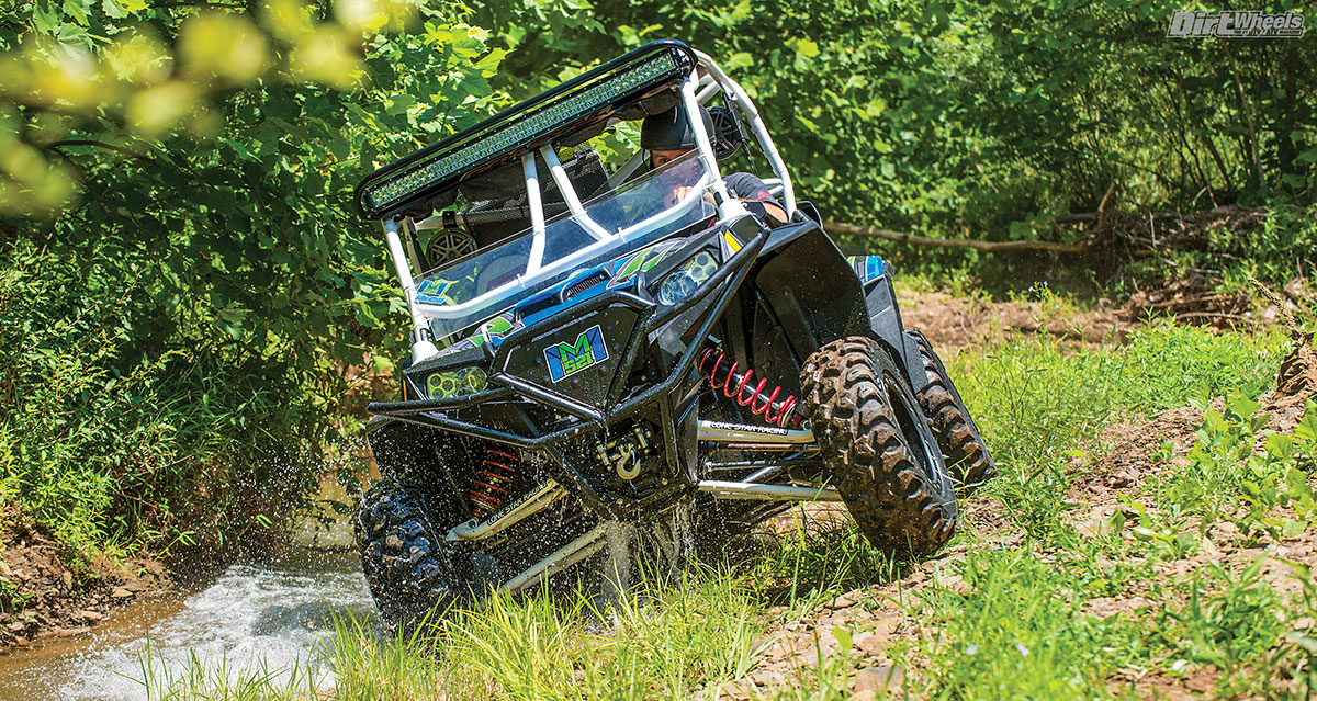This rig was built for Adam to unwind from the rigors of being a professional ATV racer. Just like us, he finds great joy in driving his baby with his buddies on the off weekends. The custom MM521 (McGill Mafia 521) logo by Loud Performance glows green on this Blingstar bumper with the flip of a switch. The trusty Warn winch will get this UTV out of almost any predicament.