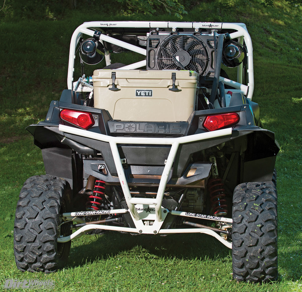 Lonestar Racing's high-clearance radius rod kit clears most obstacles with ease. The raised radiator location keeps the RZR from overheating, while the Yeti cooler keeps Adam from doing the same.