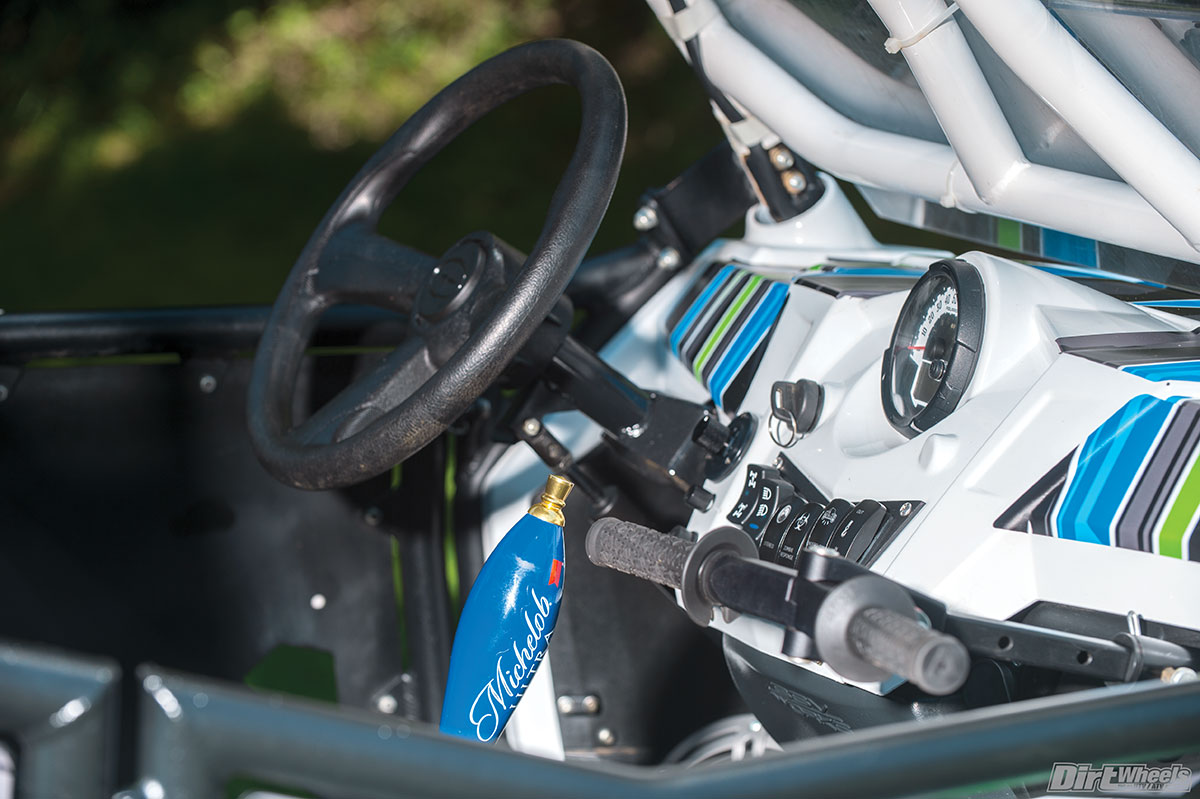 Fasst Company's Co-Pilot grab bar gives the passenger some much-needed comfort, especially when McGill is driving! That custom Michelob Light gear shifter is Adam's favorite part.