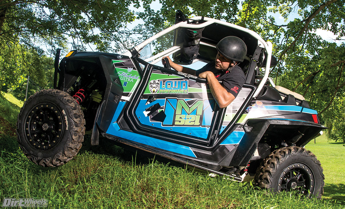 This RZR XP 900 has the power and ground clearance to get you over pretty much anything that we come across. The Hiper beadlock wheels and the CST Behemoth tires really cut through the wooded terrain with the best of them. Then there's Adam in the driver's seat showing us the classic McGill humor.