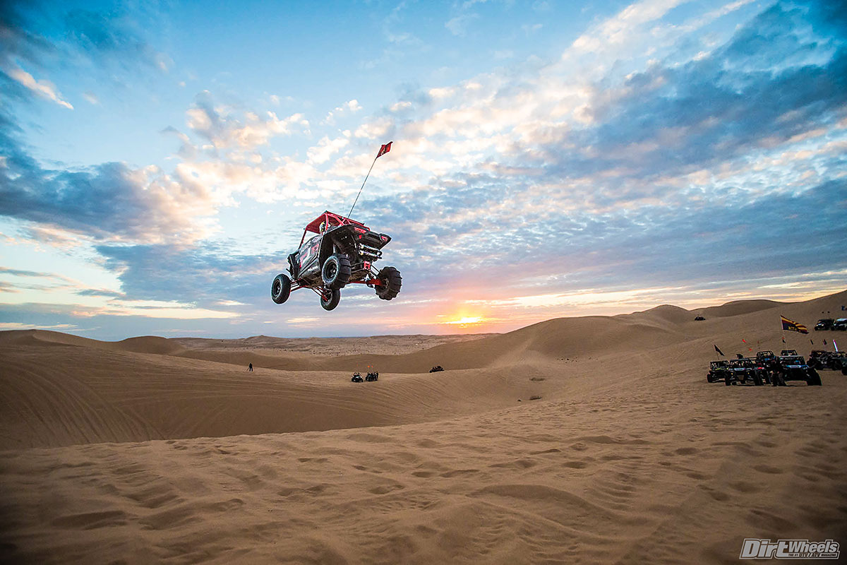This is what most of the people trekking to Glamis are looking for—thrills and excitement in the dunes. While this looks pretty crazy, spotters are checking to make sure the coast is clear before going for air tricks.