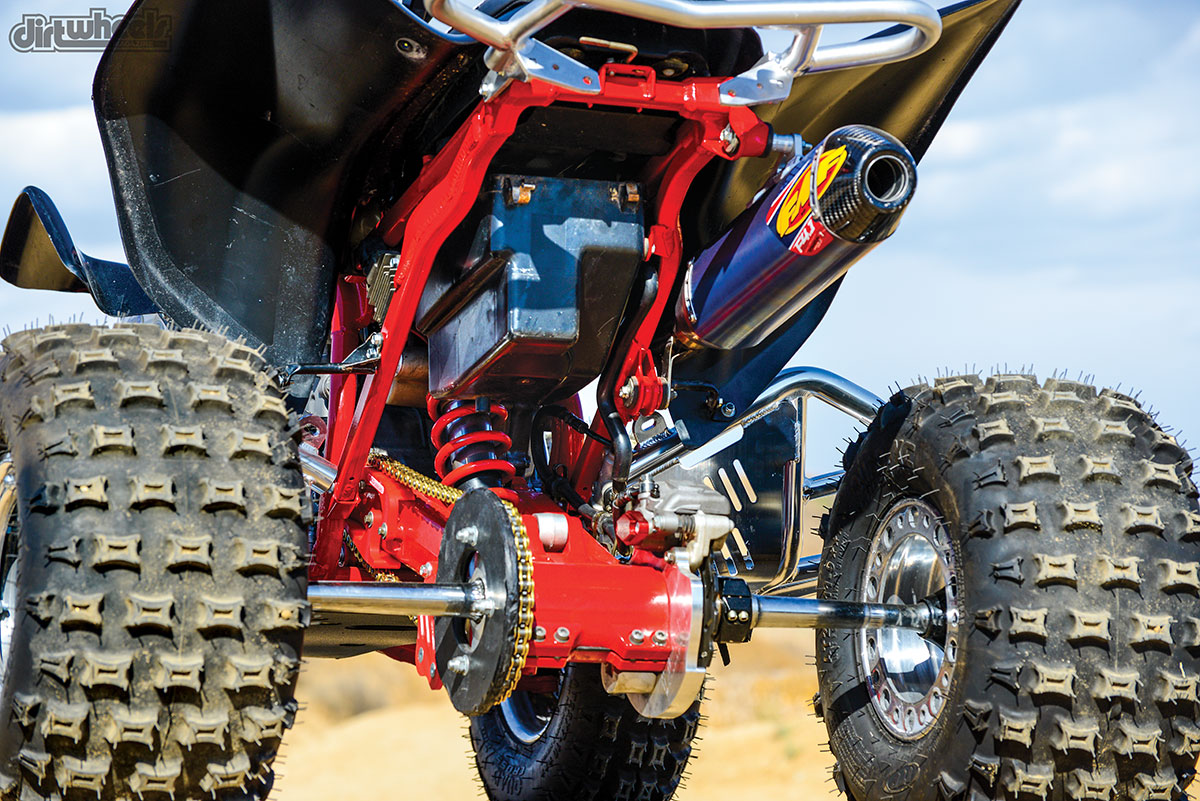 CRF Racing poly sprocket guard, CRF Racing poly belly pan and Hess Motorsports billet rotor guard keep everything protected on this beast. The Tusk adjustable axle that we used has a lifetime warranty and is inexpensive compared to other brands.