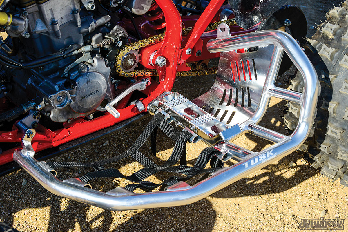 The Tusk nerf bars gave us sure footing. Primary Drive's sprocket and chain kit provide quality at a budget price. Moose Racing's poly case saver keeps the cases safe, while TM Designworks' Slide-N-Guide kit gave us every chain roller.