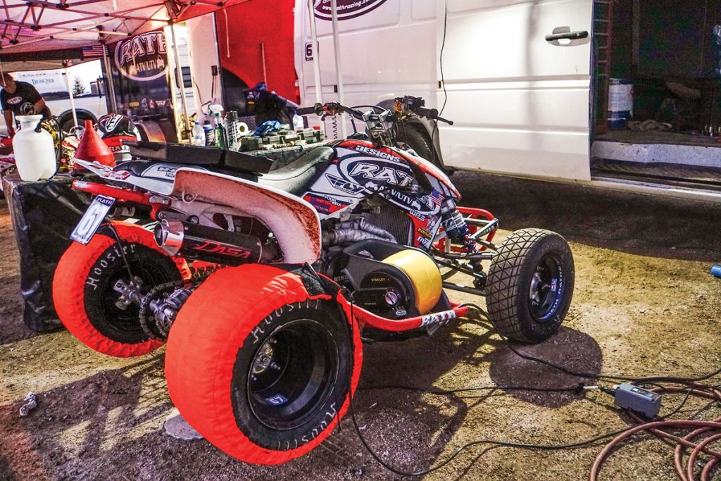 Pro racer Daryl Rath is a seasoned veteran and knows more racing tricks than most. You can see that he takes his racing seriously by using rear tire warmers before each race. Like Moto GP racing on two wheels, this trick gives the tires more traction on hardpack dirt.