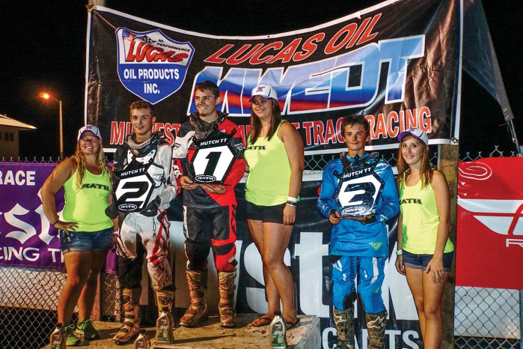 All smiles here from the podium. In general, the Midwest Extreme Dirt Track series and TT racing are one big family, and being that I was a new entry into this world, I was quickly accepted into it.
