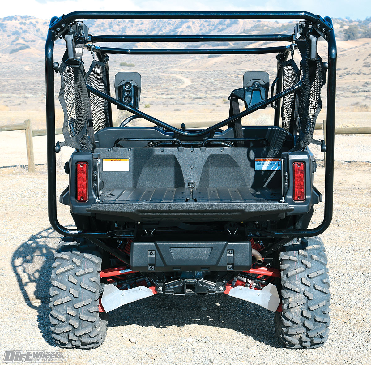 Red paint on the A-arm and shock springs and the aluminum A-arm guards are all specific to the Limited Edition. The cage comes to the back of the machine since two additional seats make up the bed floor.