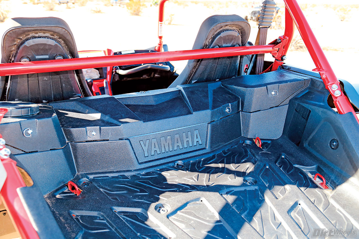 The Yamaha doesn't have a complete bed, but more of a platform with three sides and tie-down points to hold your gear in place.